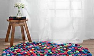 Make a Colorful Pompom Rug