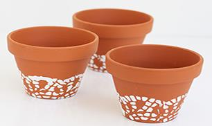 Diy doily painted flower pots